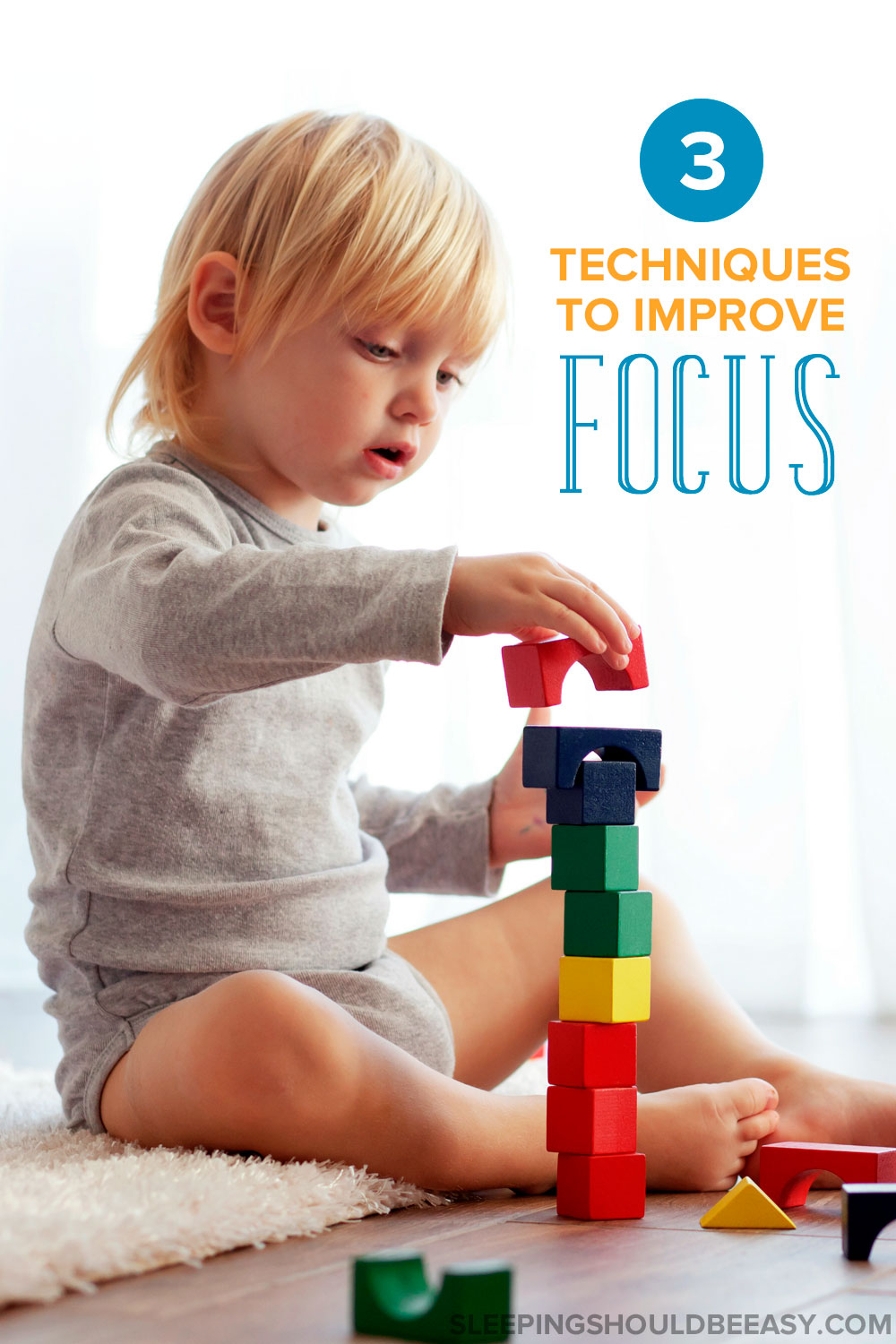 3 techniques to improve focus: a toddler boy stacking blocks