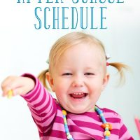 A little girl pointing in the middle of an after school schedule at home