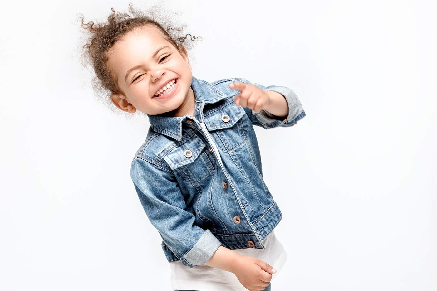 Funny little girl smiling and dancing