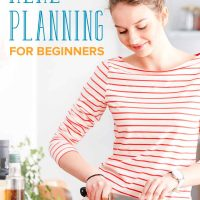 Woman chopping food in her kitchen: meal planning for beginners