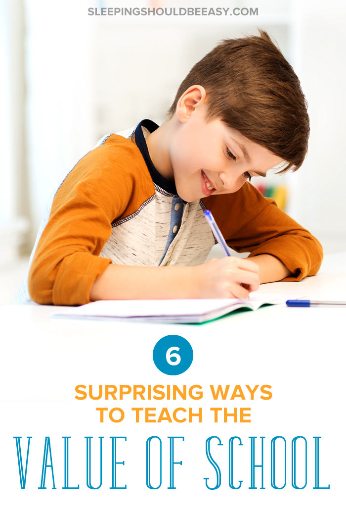 Little boy writing and learning the value of school