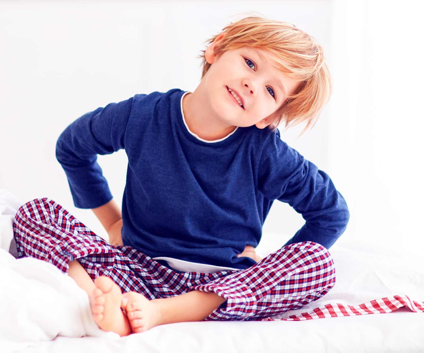 a happy, smiling boy sitting down