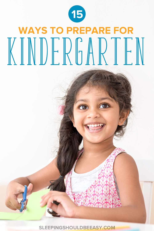 A little girl cutting with scissors as part of kindergarten prep