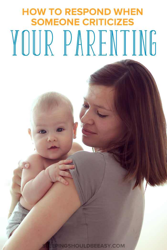 A mom carrying her baby: how to respond when someone criticizes your parenting