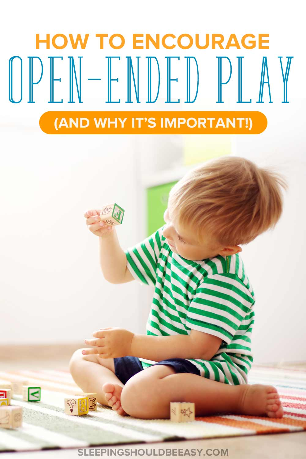 A little boy in the middle of open ended play