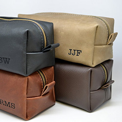 Father's Day gift idea: Personalized leather toiletry bag. Replace his old tattered one with a long-lasting one.