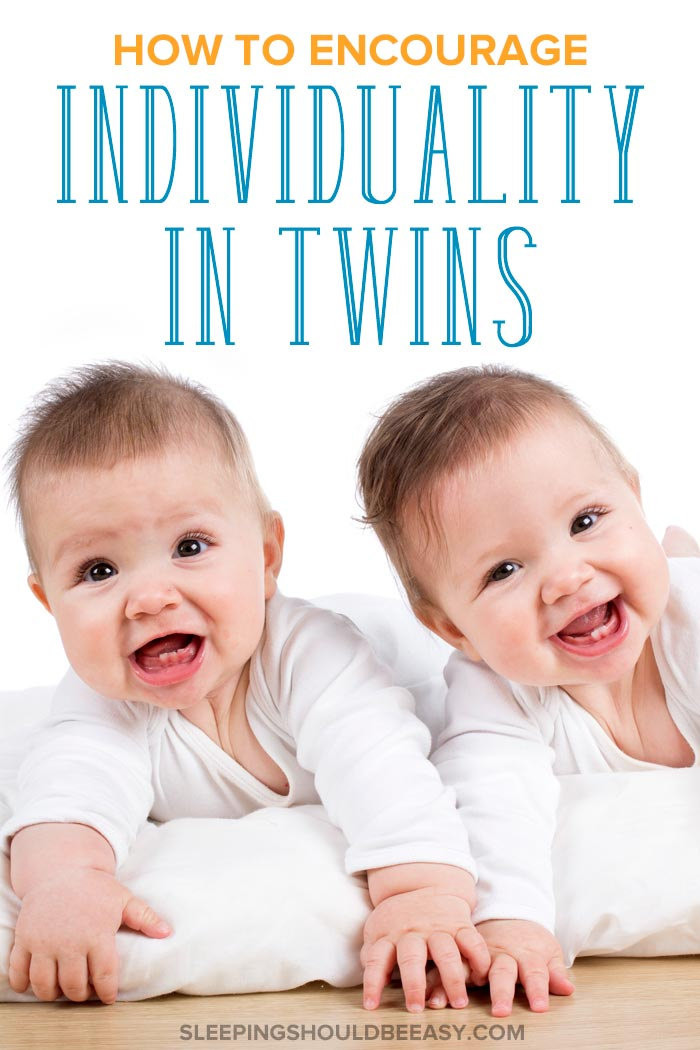 Two babies celebrating individuality in twins