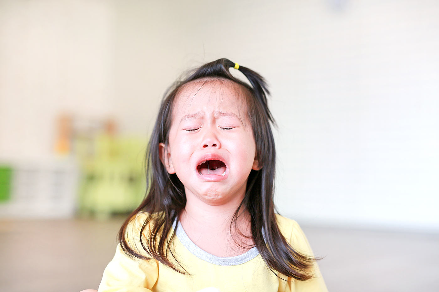 Little girl crying and upset