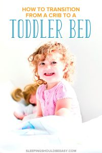 Little girl smiling, going from crib to toddler bed