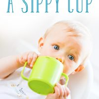 7 easy ways to transition to a sippy cup: Little boy holding a green cup