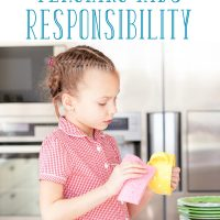 Girl washing dishes: 4 benefits of teaching kids responsibility