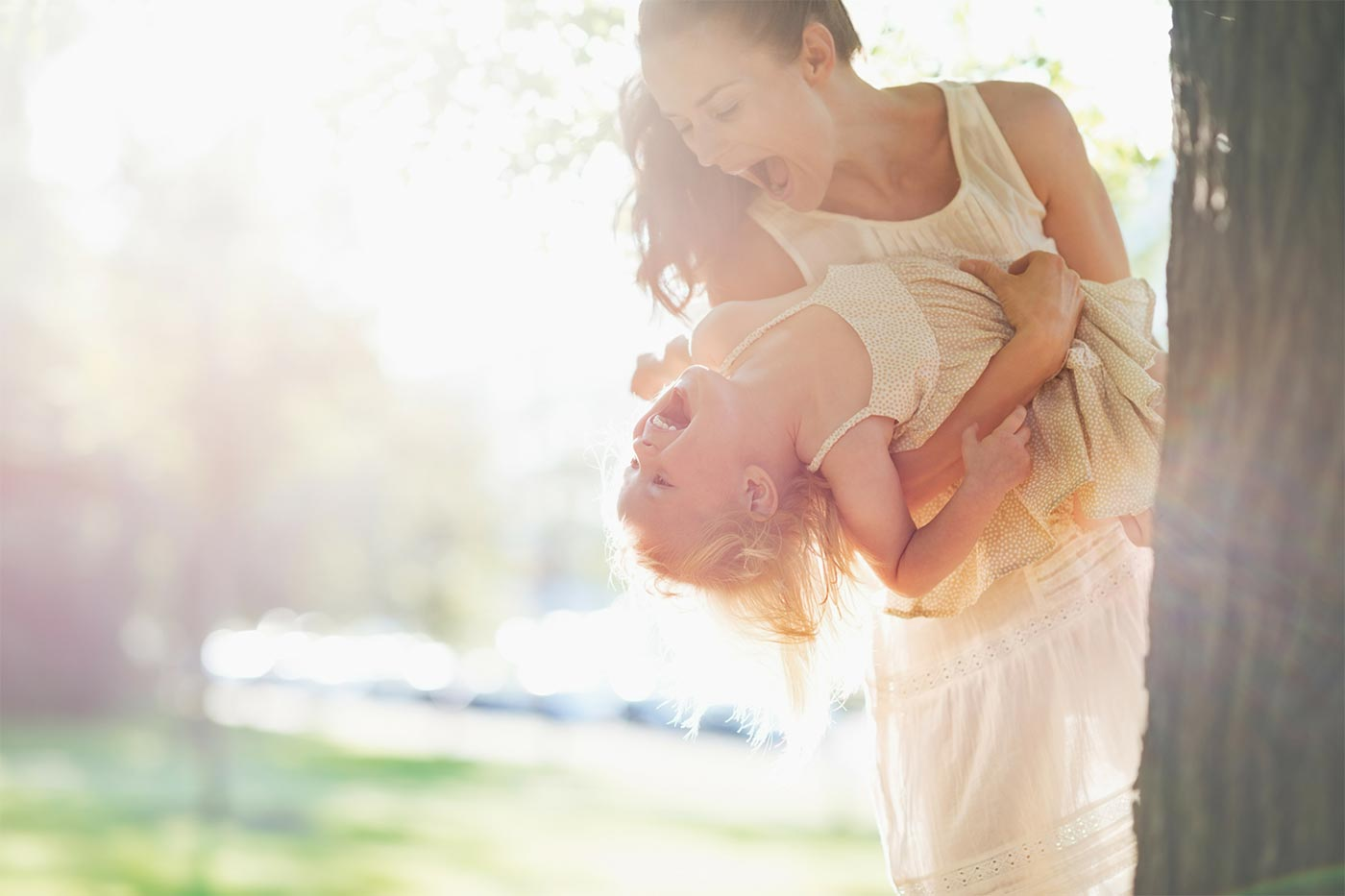 Mom carrying her daughter outdoors