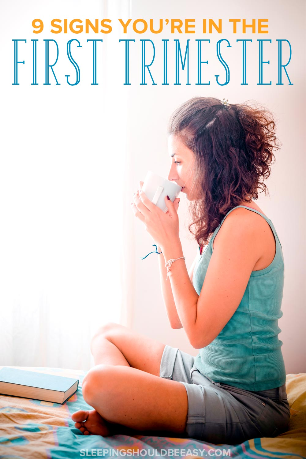 9 signs you're in the first trimester: Woman sitting in bed, dripping a cup of tea