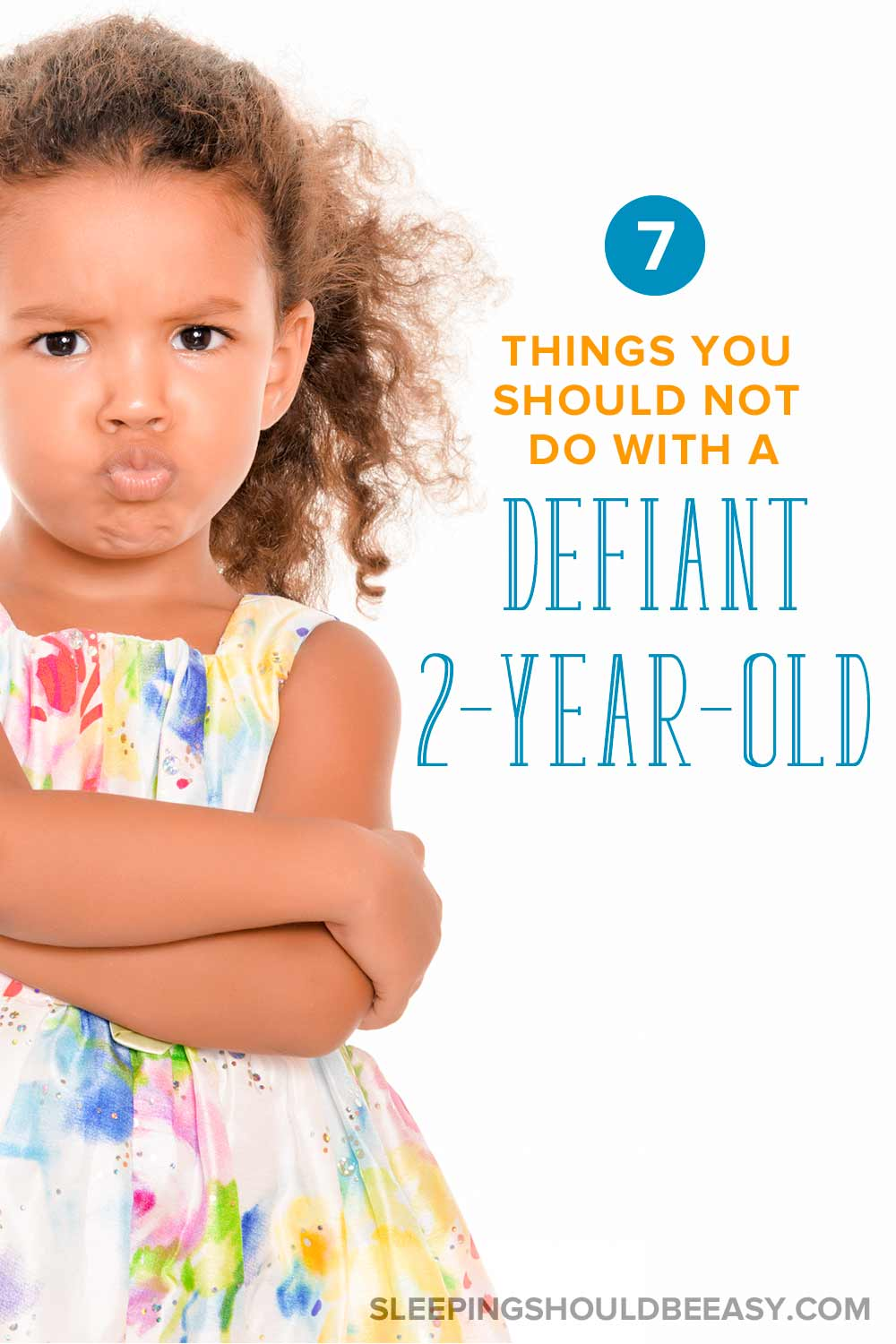 Defiant 2 year old girl with her arms crossed