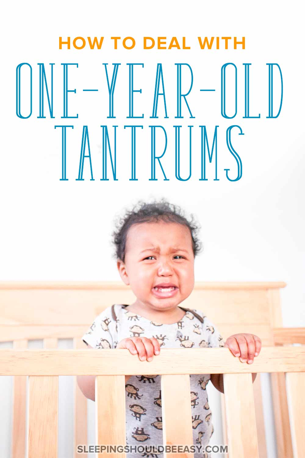 1 year old boy throwing a tantrum and crying, standing in a crib with hands