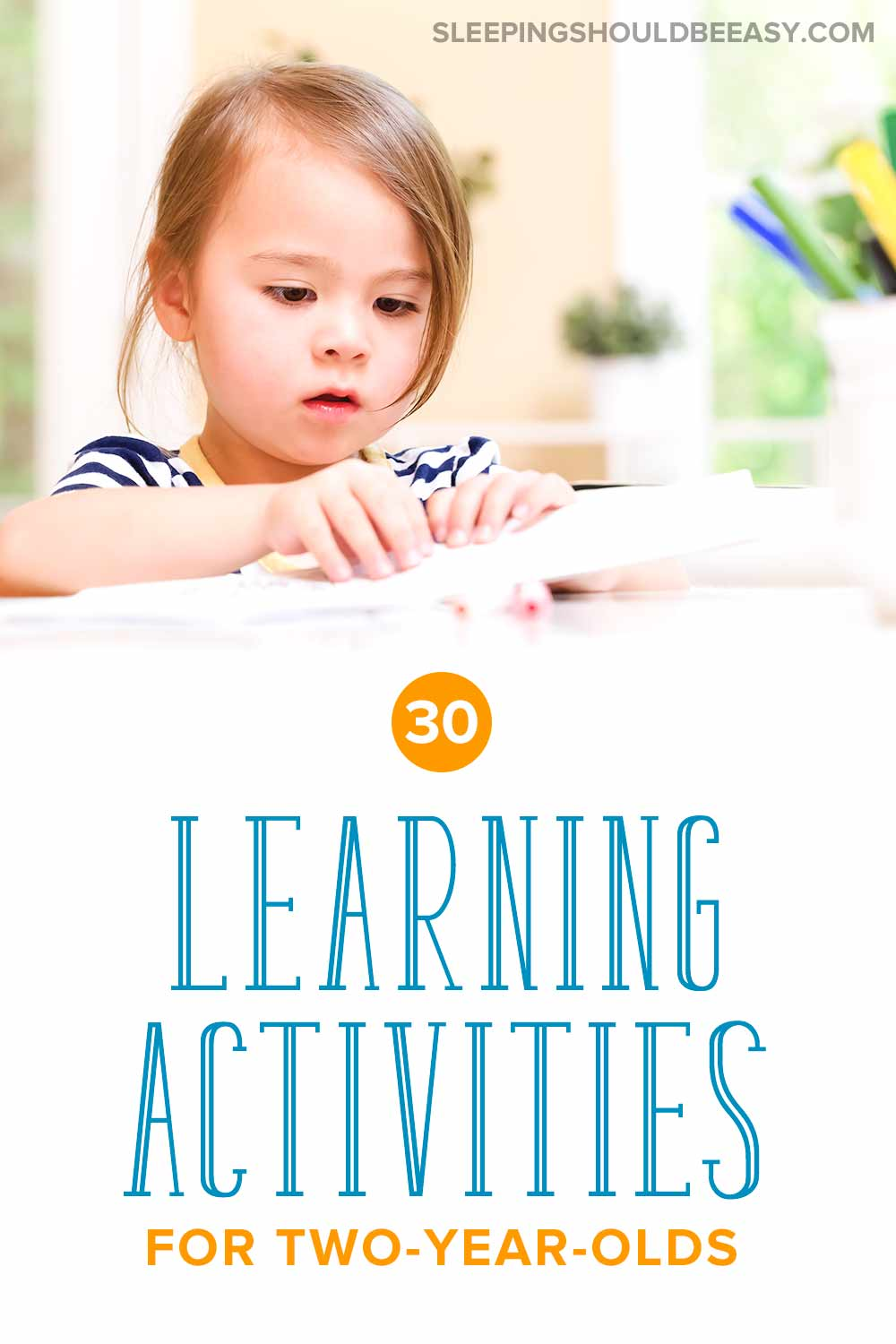 Little girl doing learning activities for 2 year olds