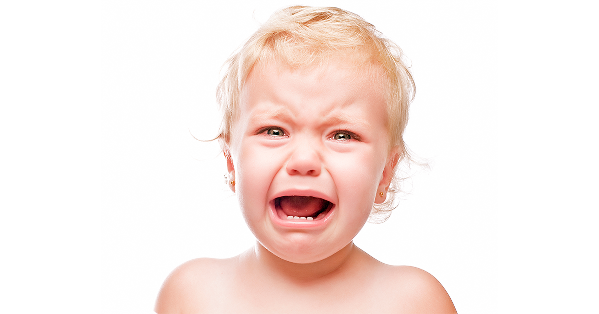 Toddler boy's face, crying and upset