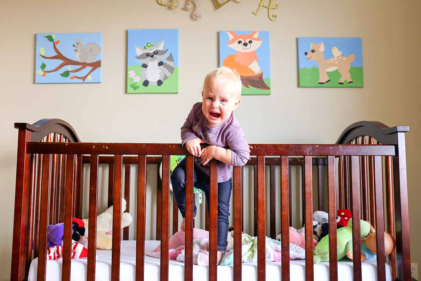 Toddler climbing out of crib and crying