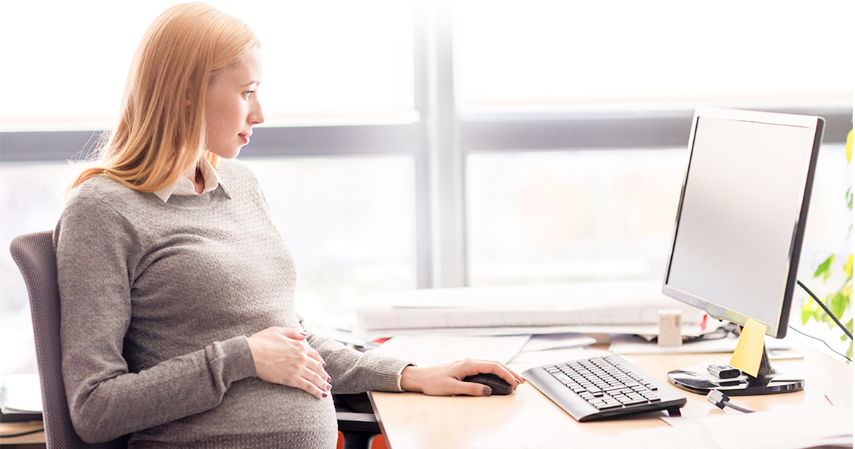 Pregnant woman working on her computer