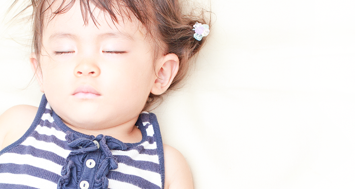 A toddler girl sleeping