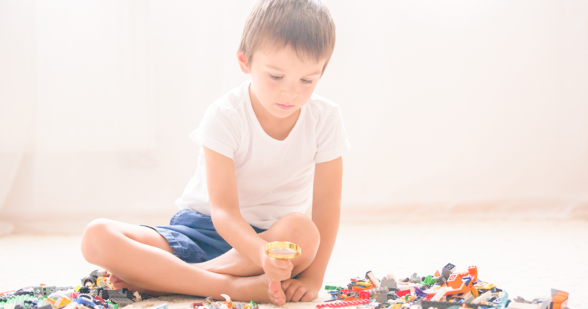 Boy playing with building toys