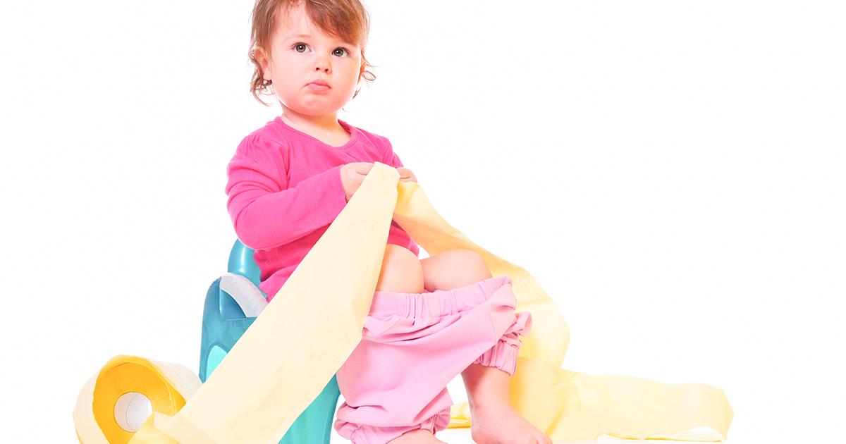 A little girl sitting on a potty