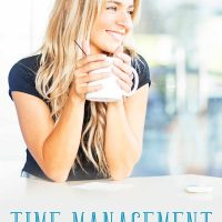 A happy mom holding a cup of coffee: time management for moms