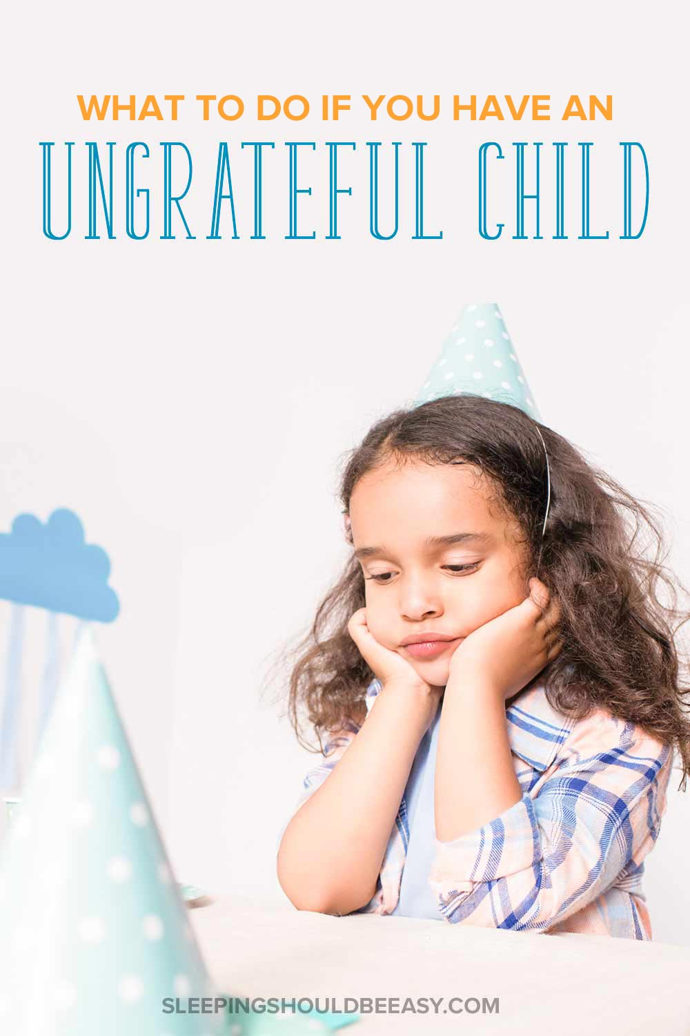 Sad, ungrateful child with a birthday hat