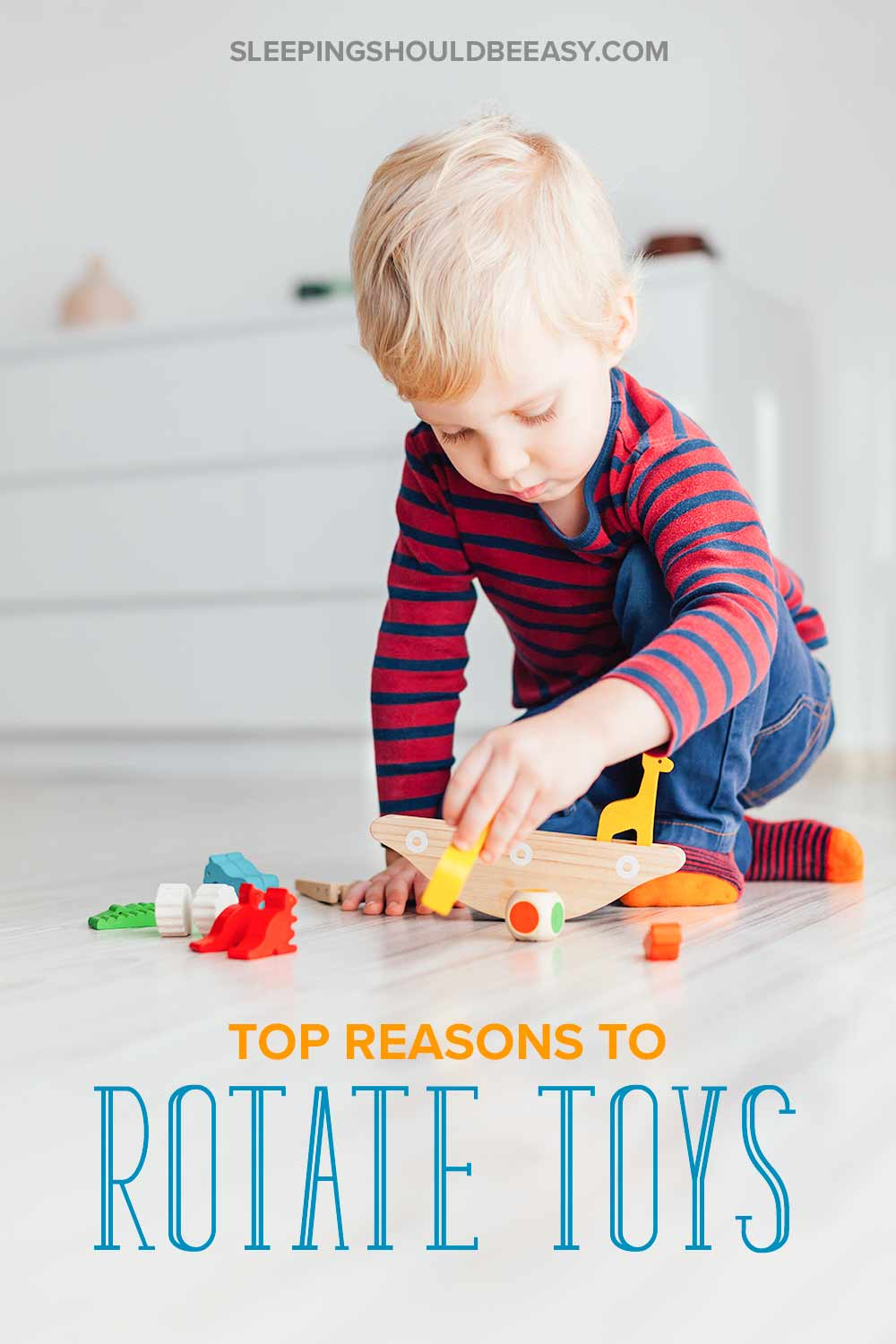 A little boy playing with wooden toys: Top reasons to rotate toys