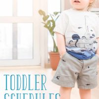 Toddler schedule: Little boy standing with his hands in his pockets