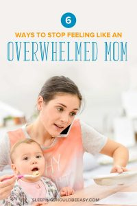 An overwhelmed mom on the phone and feeding her baby