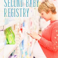 Pregnant woman shopping for her second baby registry