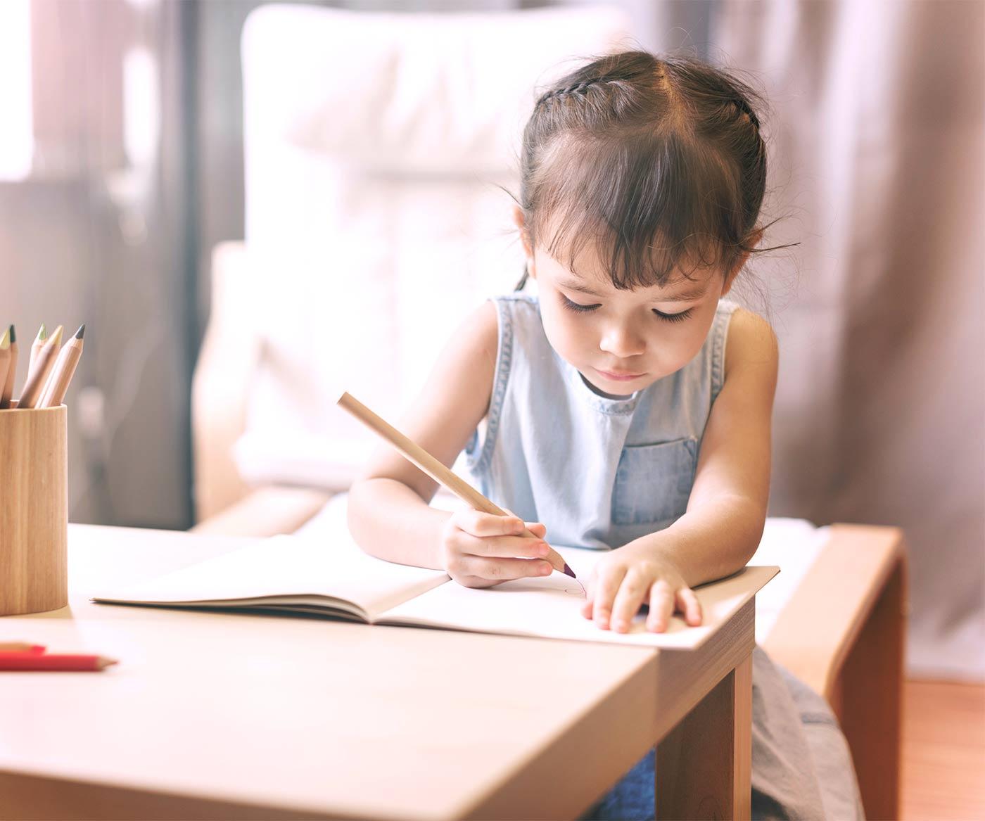 A little girl writing