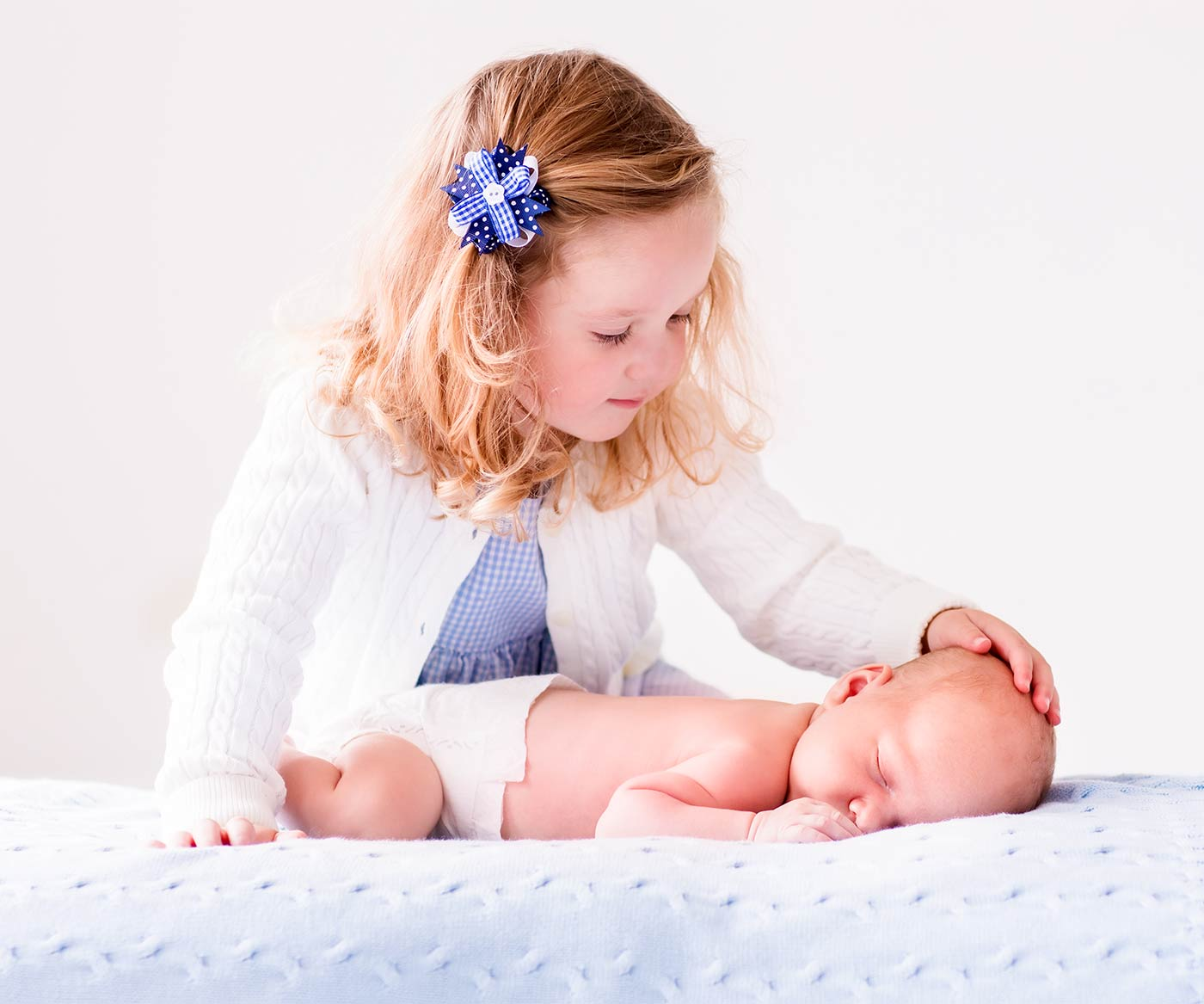 A newborn and toddler together