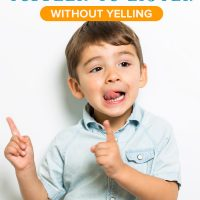 A little boy smiling: how to get toddlers to listen without yelling