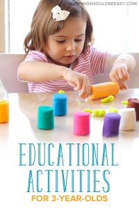Little girl playing with play dough and doing educational activities for 3 year olds