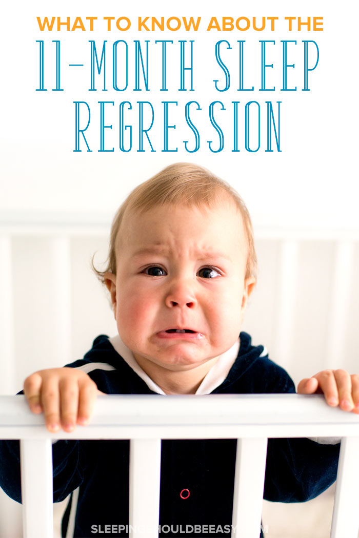Little boy crying in a crib and going through the 11 month sleep regression