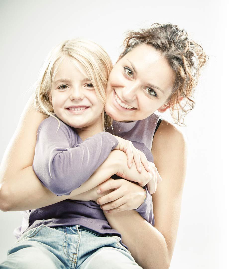 Mom hugging her daughter